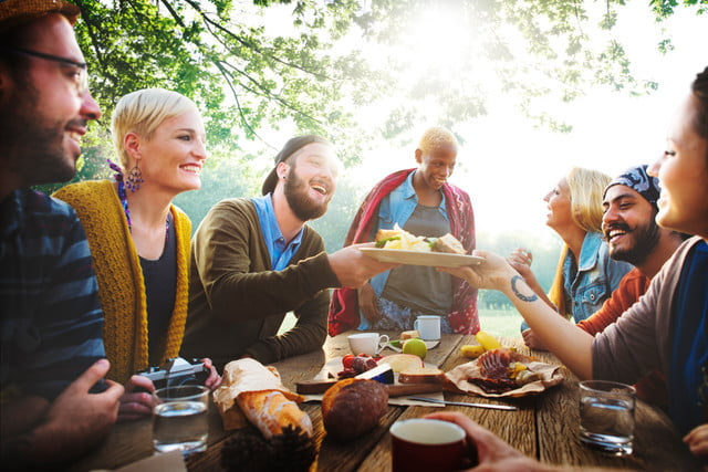 foodniche diverse people luncheon outdoors food concept