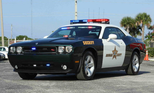 incredulous cop cites man using smartwatch driving dodge challenger rt police car by thecarloos
