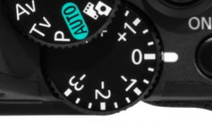 On a camera like the Canon PowerShot G15, there is a physical dial to adjust exposure compensation.