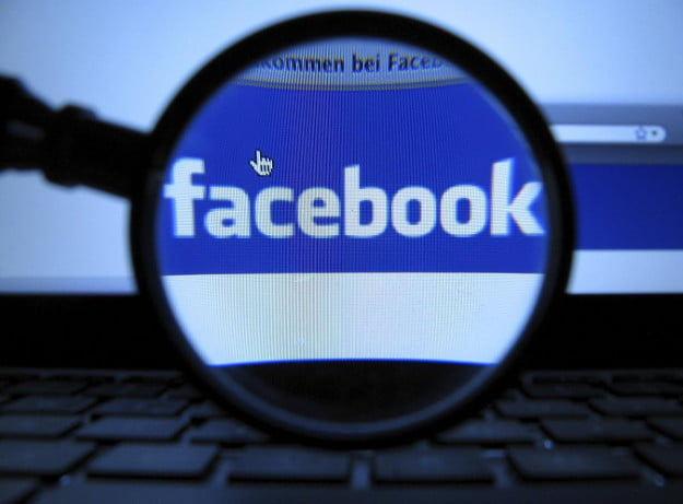 facebook under a magnifying glass