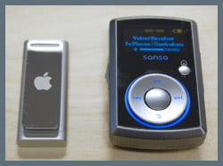 A Third-Generation Apple iPod Shuffle and a Sandisk Sansa Clip