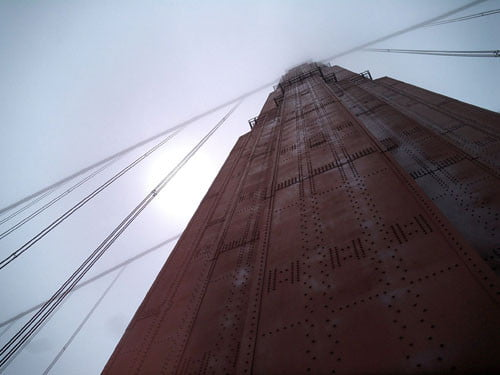 Shooting up one of the massive pillars of the Golden Gate Bridge reflects its immensity.