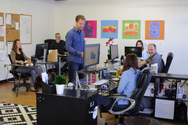 Andrew Funderberg speaks to employees at the Fundy Software office.