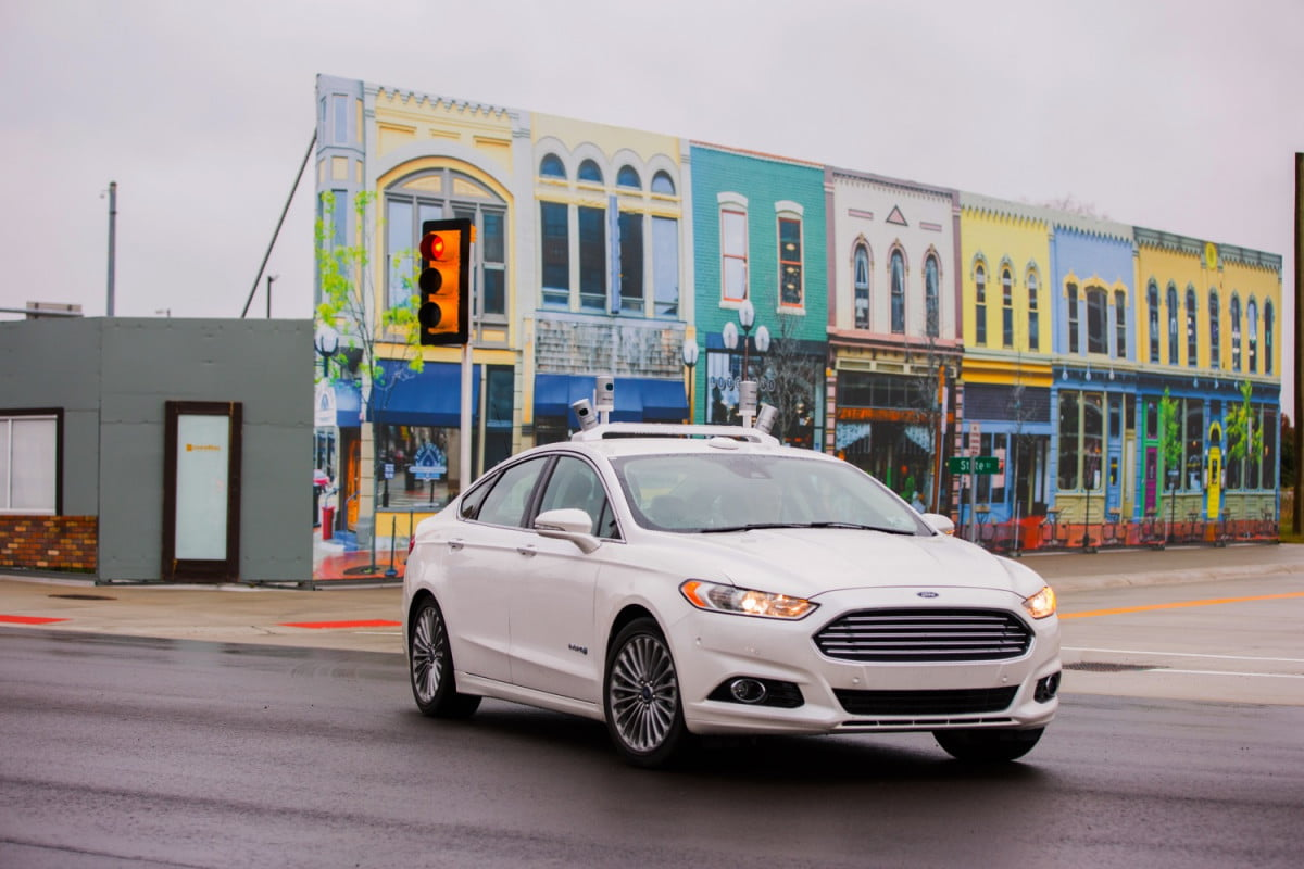 fords fusion hybrid autonomous prototype roams the streets of a simulated city ford research vehicle at mcity