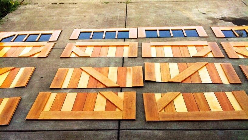 Give your boring garage door a makeover with these wooden for Garage door wood overlay