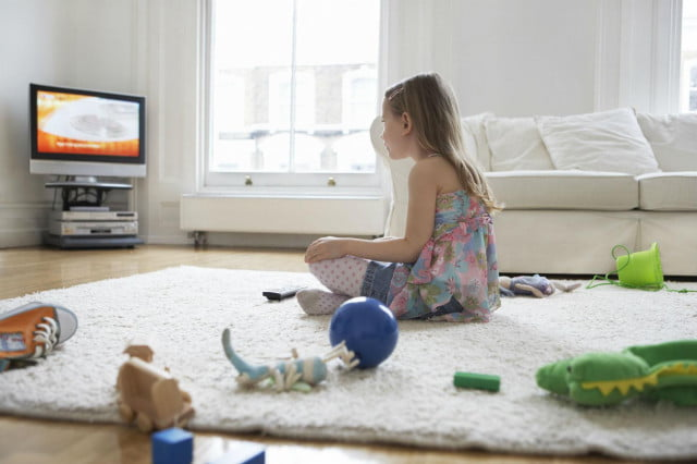 Girl watching TV instead of playing