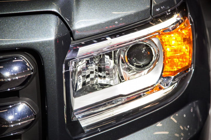 gmc canyon european refinement mated unabashedly american truck headlight