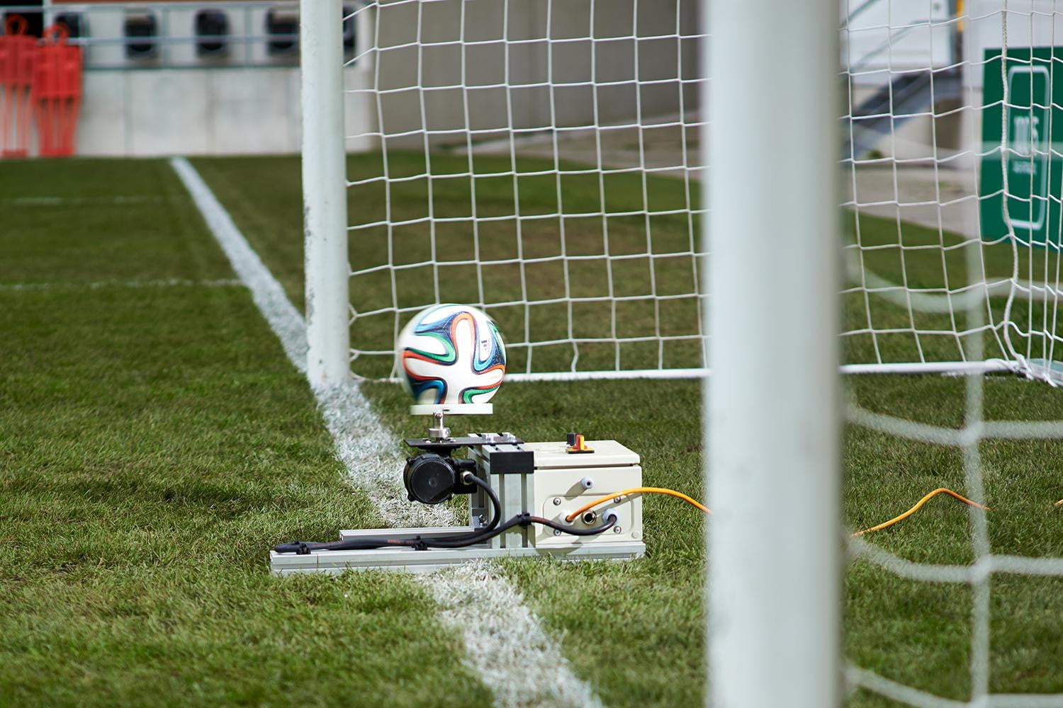 When the ball crosses the goal line, the system sends a signal to a ...