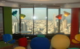 Employees get to lounge and admire a fantastic view while working in style. [image via Google Tel-Aviv]