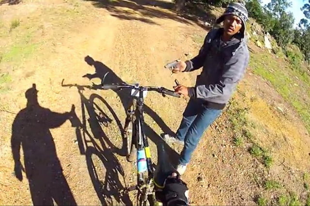 A biker films himself being robbed at gunpoint In South Africa.