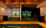 This media room is split for golf on one side, and hunting on the other.