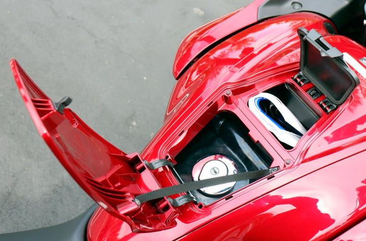 honda ctx review  candy red fuel tank and integrated storage compartment
