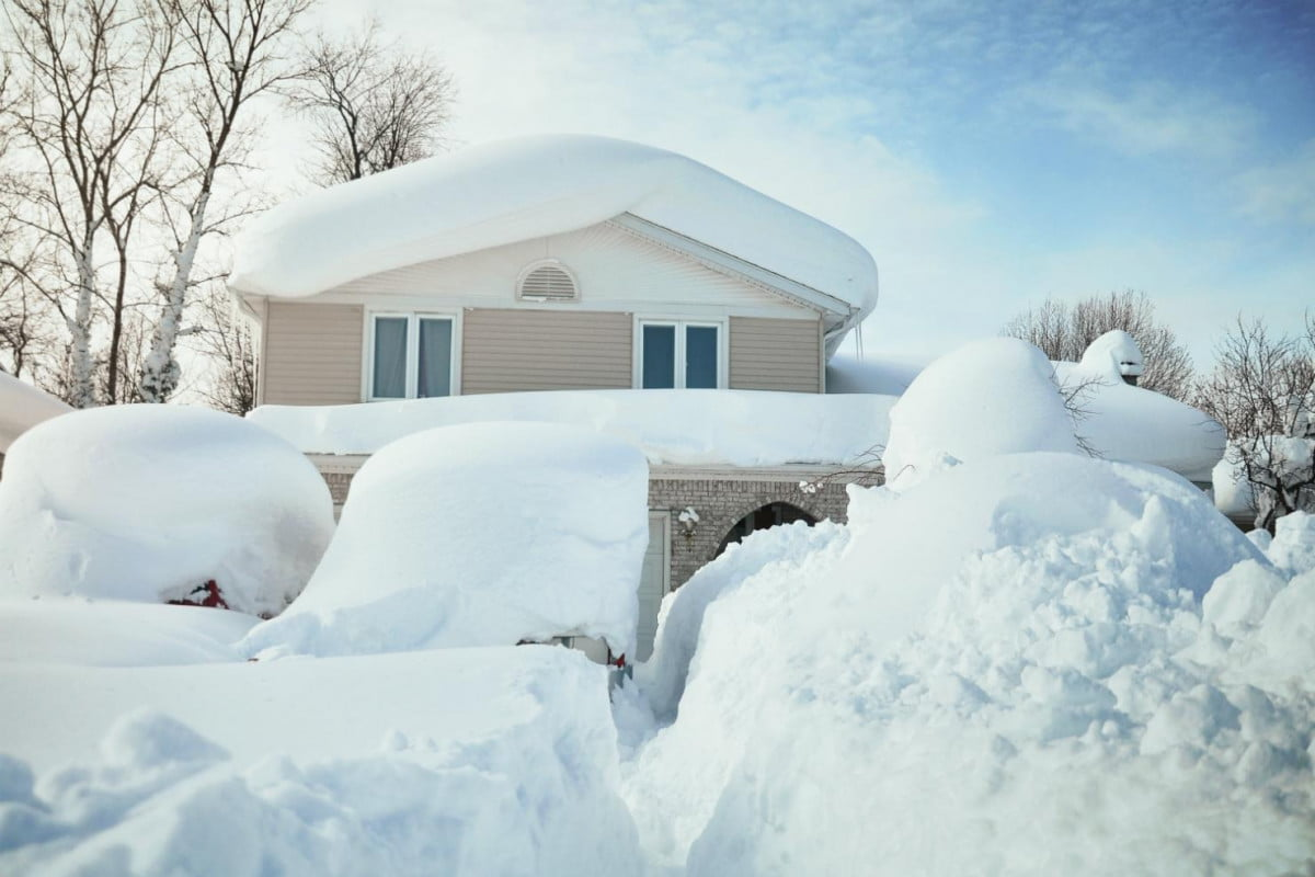 getting your home ready for a blizzard house burried in snow by
