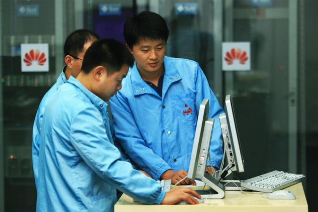 huawei confirms exit from u s telecoms market engineers at work