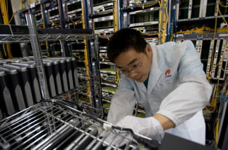Huawei R&D staff performing routine maintenance