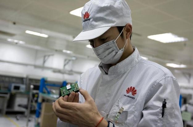 Huawei R&D staff performing routine maintenance at a testing center
