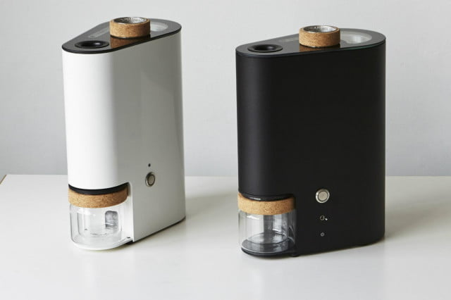 the ikawa home roaster roasts coffee beans at pro (black) with (white)