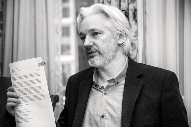 wikileaks holding zero day exploits until developers fix them julian assange cia v