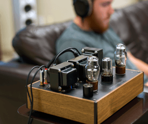 Buy the Kenzie tube amp for its gorgeous guts, keep it for the golden glow