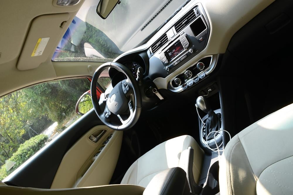Kia Rio review interior drivers from back compact 2012