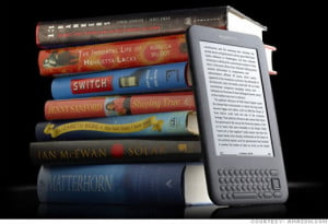 kindle against stack of books