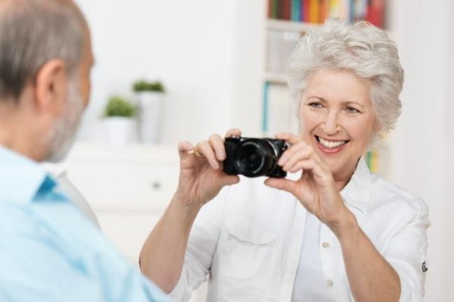 put crosswords pick camera study shows photography improves memory lady with