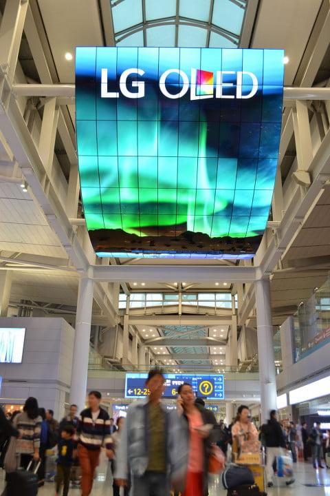 lg flexes its oled muscles with pair of  foot tall monster displays display