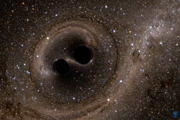 A computer simulation showing two black holes colliding with one another