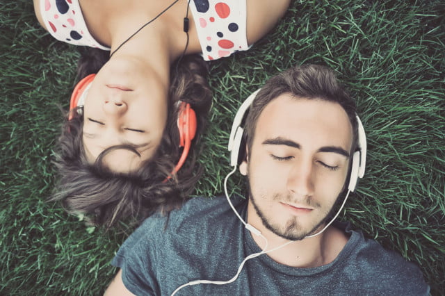 wetransfer music streaming platform man and woman listening to