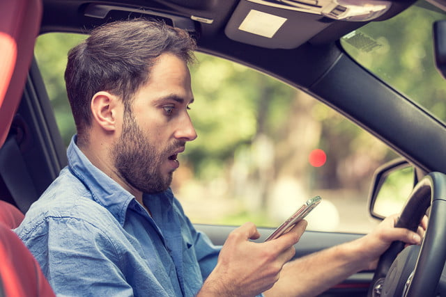 samsung in traffic reply man sitting car with mobile phone hand texting while driving
