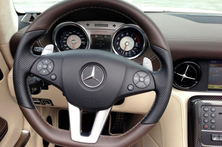 forget the lamborghini stud amgs sls gt is gentlemans sportscar mercedes benz amg roadster interior sterring wheel