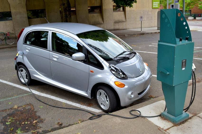 Mitsubishi i MiEV review exterior front left plugged in electric vehicle