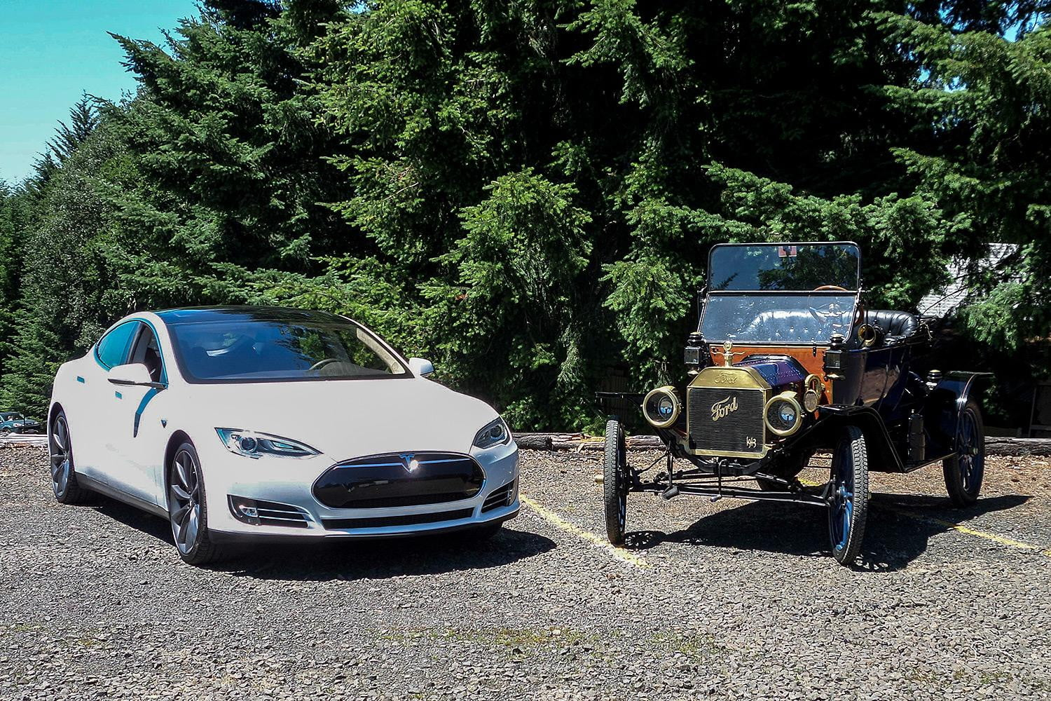 Tesla Model S next to a Ford Model T