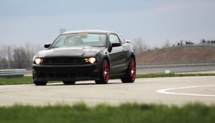 ford mustang boss review black laguna seca corner
