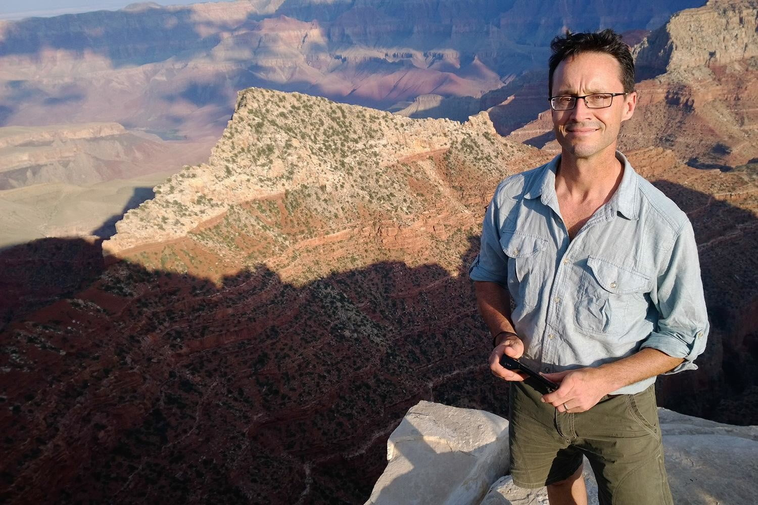National Geographic photographer Stephen Alvarez, on assignment and standing on top of the world (of sorts).