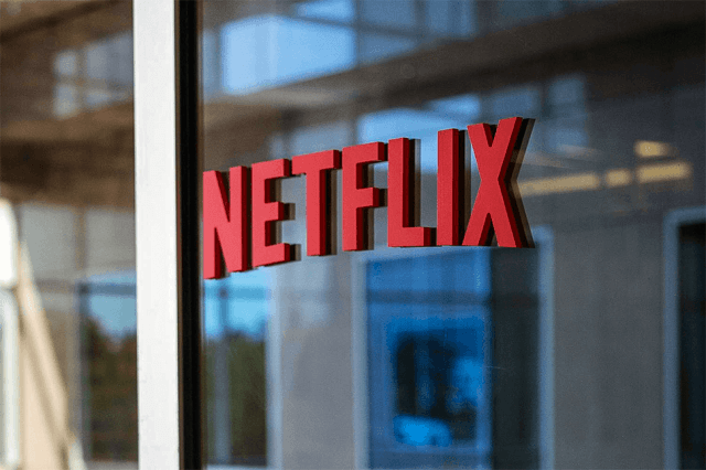 netflix stock surges service adds new features