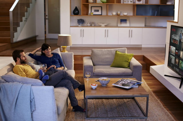 french service provider puts netflix in set top boxes couple living room