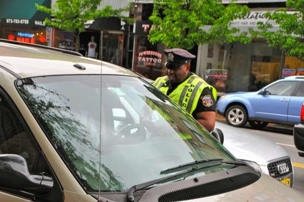 Police Officer: 'License, vehicle registration - and cell phone'