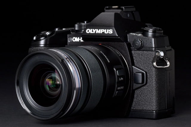 olympus forecasts camera business will return profit  focuses mirrorless om d em front left angle