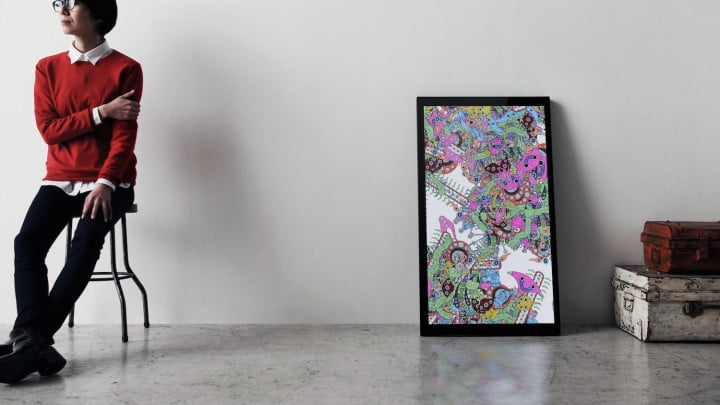 framed digital canvases kickstarter on chair in front of with pink art high res