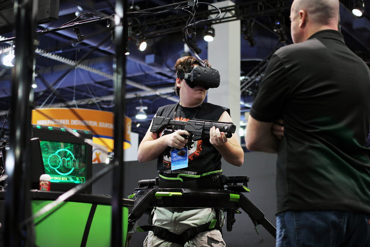 virtual reality and exclusivity palmer luckey playing with virtuix omni