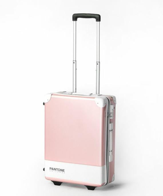 pantone carry case luggage bags make for a colorful trip pink