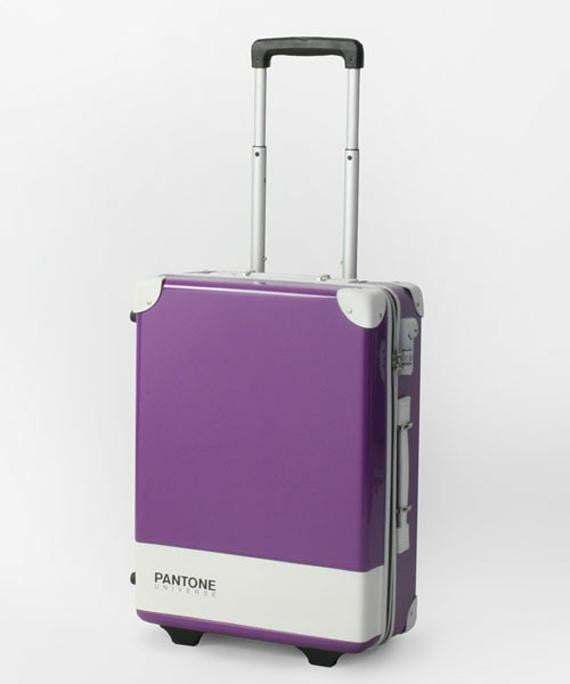 pantone carry case luggage bags make for a colorful trip purple