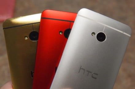 Three HTC One's in a fanned formation.
