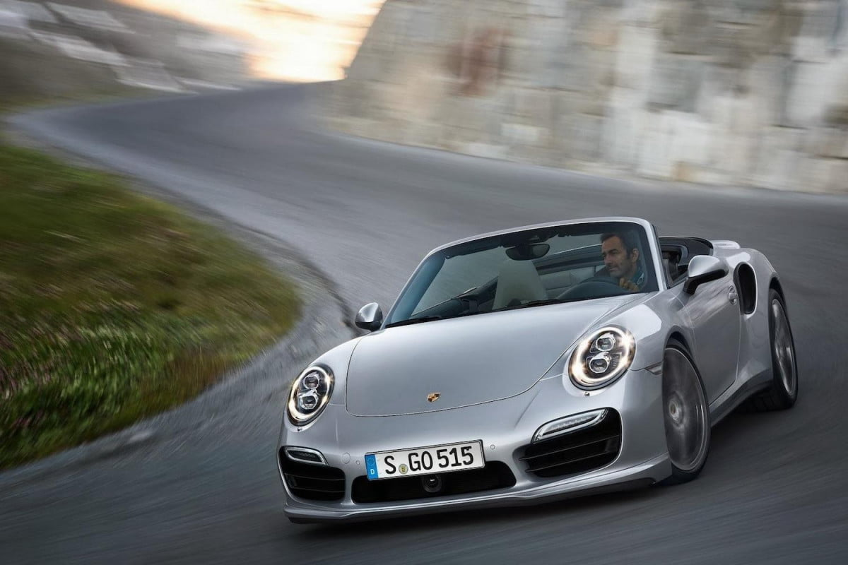 quite nearly worth their weight in gold porsche unveils the  turbo and s cabriolets cabrio