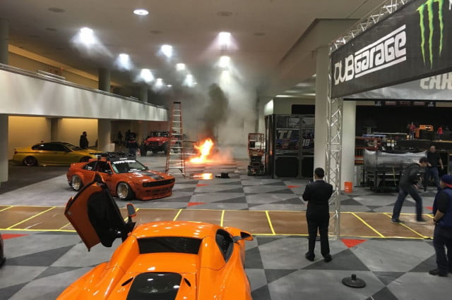 a custom porsche  turbo goes up in flames at the new york auto show fire