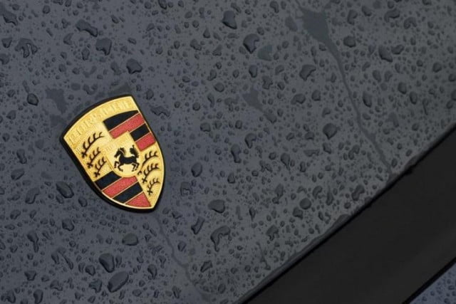 fresh accusations drag porsche into vw emissions cheating scandal logo