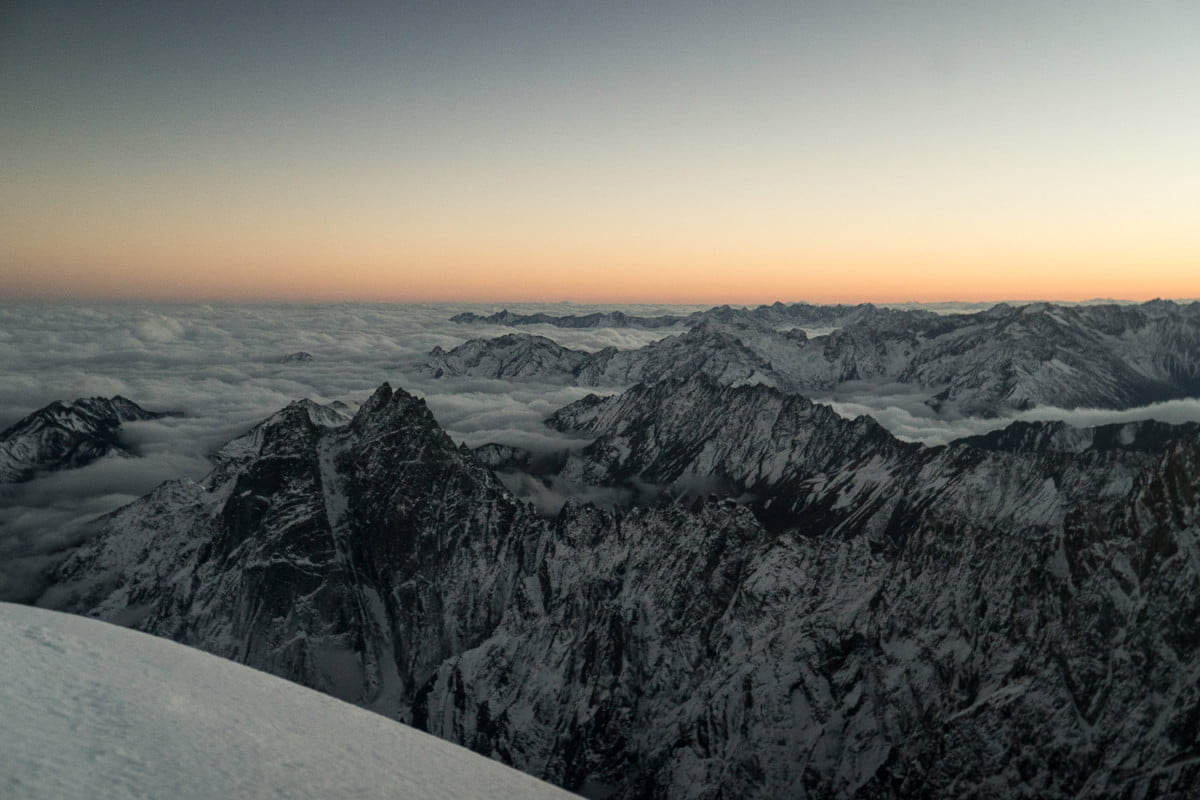"""""""This photo was taken on our final summit push on Hkakabo Razi. The humid jungles to the south created a sea of clouds below. It was minus-20-degrees Fahrenheit, and we only had one sleeping bag between us to go light on our final attempt to reach the top.""""  Read more: http://www.digitaltrends.com/photography/scaling-asias-anti-everest-mountain/#ixzz4Uf6pOBzJ  Follow us: @digitaltrends on Twitter   DigitalTrends on Facebook"""