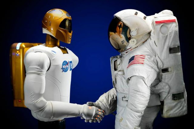 space stations robonaut takes delivery of legs