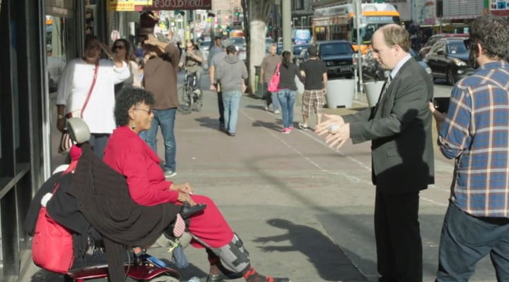 The woman in the wheelchair tells J.D. Walsh she's willing to be in the film.